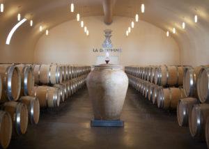 Barrels in the cellar at Château de la Dauphine in Bordeaux