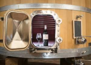 a bottle of wine by domaine de la font des pères winery in a barrel