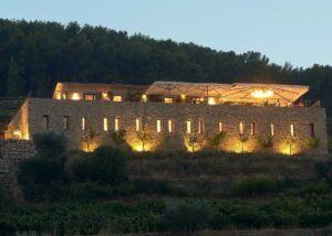 lit building of domaine de la font des pères winery