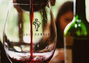 pouring wine into wine glass at lidio carraro boutique winery