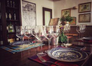 Magic wines and glasses prepared for tasting in winery of La Cantina di Andria.