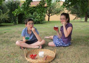Château Bardins - children in the garden tasting grape juice