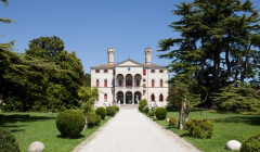 Gardens and the white castle in the winery Castello di Roncade.