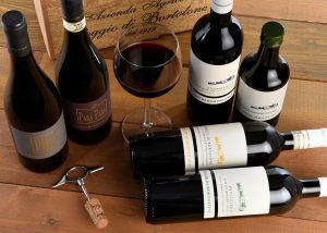 six bottles of wine and glass from amazing poggio di bortolone winery.