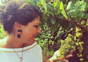 Sorrentino Vesuvio worker overviews grapes at vineyard during summer