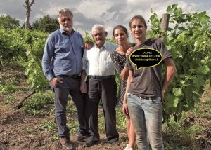 michele laluce four winemakers amid lush vineyards near winery