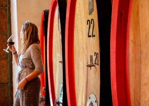 wooden barrels inside winery Villa San Carlo located in Italy