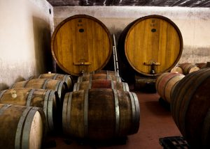 Wooden barrels and large tanks for ripening wine at the Palazzone winery.