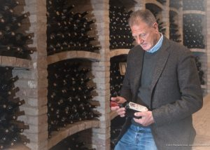 winemaker at Terre Di San Vito winery cellar tasting wines