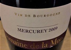 A bottle of red wine at Domaine de la Monette in Burgundy