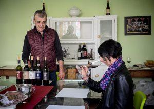 eraldo viberti visitors enjoying wine in room for wine tasting sessions