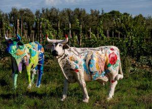 painted cows standing in front of Tenuta Biodinamica Mara vineyard in Italy