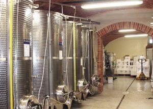 modern wine tanks inside Manera Fratelli winery in Italy