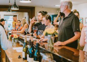 People tasting wine in the tasting room of the Bien Nacido & Salomon Hills Estate