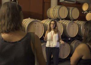 Empordàlia_wine explanations among barrels_3