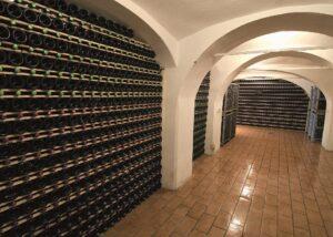 Istenič many bottles of stunning wine on shelves inside winery