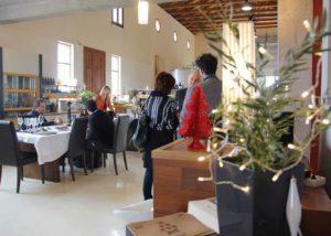 People tasting wines in the tasting room of the Koroniotis Winery