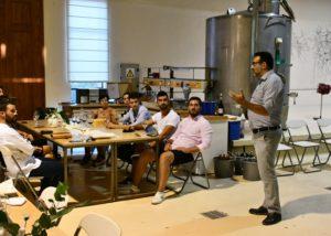 A group of people tasting wine at the Koroniotis Winery