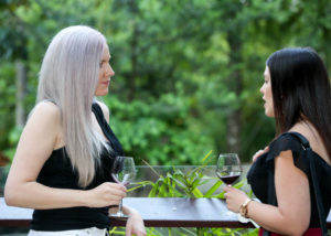 Levrier by Jo Irvine Tasting wine on a terasse