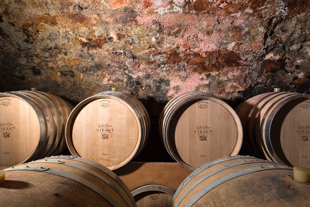 The barrels in the cellar at Château Virant