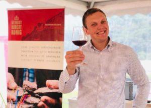 The winemaker of the Weingut Robert König tasting red wine