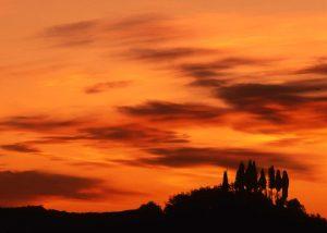 Beautiful red sunset in the vicinity of the winery Fattoria Karpineta Fontalpino.