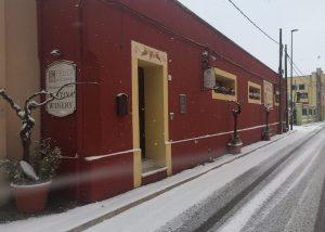 Beautiful snowy red estate of the rare winery Feudi di Guagnano.