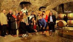 alte grafschaft winemakers family in wine cellar inside winery