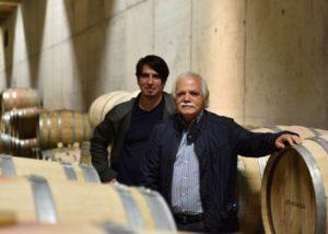 alves de sousa two winemakers near wooden barrels anside cellar