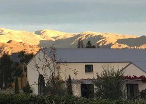 aurum wines amazing white estate against mountains in new zealand