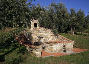 san martino old fashion stone fountain in the courtyard near winery