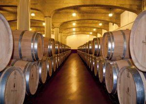 wooden barrels with wine at Bodegas Ramirez de la Piscina cellar