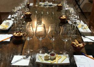 bodega sarmentero table prepeared for wine tasting session inside winery