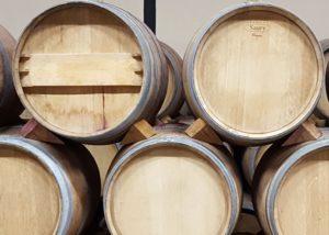 barrels full of wine made in Bodegas Iturria winery in Spain