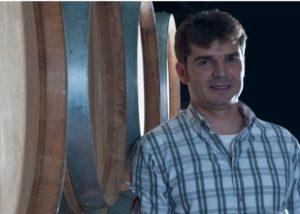 Bodegas Iturria winery owner standing near barrels in Spain