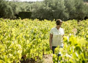 woman walking through Bodegas Robles vineyard in Spain