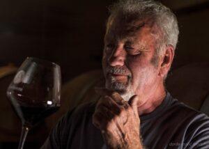 cattunar winemaker tasting great red wine in the wine cellar