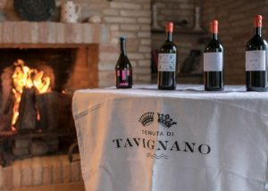 Tenuta di Tavignano bottles of wine on a table inside winery