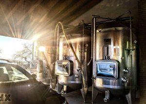 stramaret wine fermentation process inside modern tanks in Italy