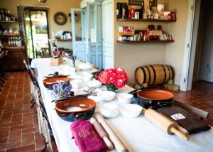 Prepared table for serving food and wine at the Fattoria di Montemaggio winery.