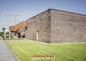 View of the striking wooden estate at Azienda Vitivinicola Enrico Crola.