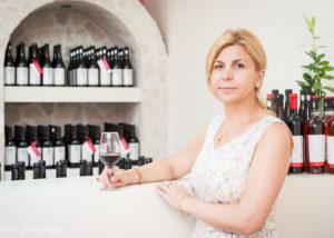 domeniile sahateni winemaker near bottles of wine inside winery