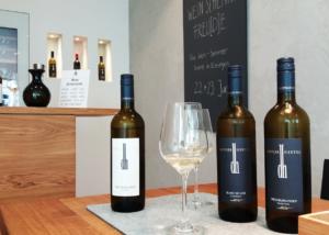doppler hertel bottles of wine and glass ready for tasting session