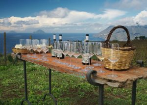table with wine and glasses in Tenuta Di Castellaro winery in Italy