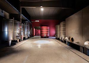 Tenuta Garetto winemaking process inside huge tanks at building in Italy