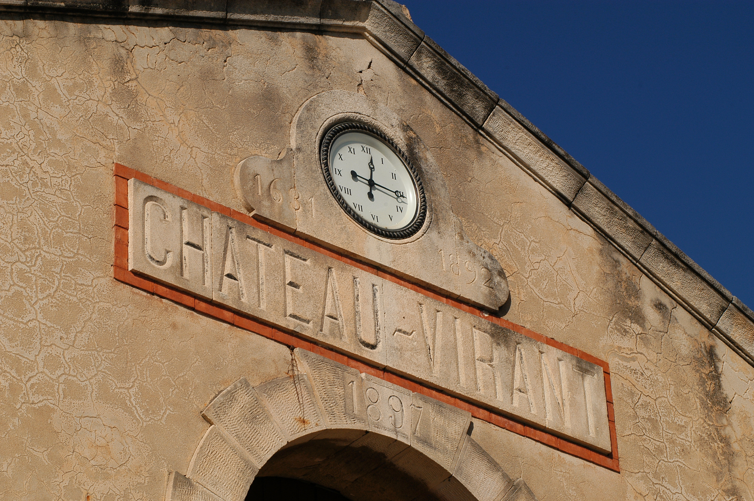 A clock on the wall of the winery at Château Virant
