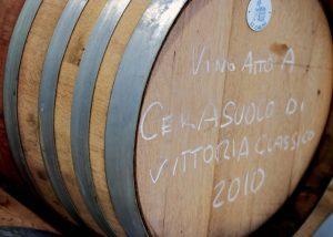 huge wooden barrel for wine aging in the poggio di bortolone winery.