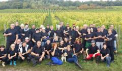 georg breuer large winemakers team on vineyard near winery in germany