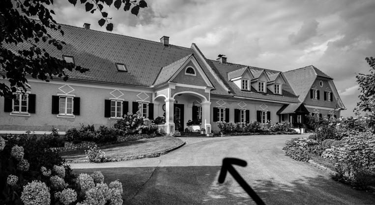 herrenhof lamprech black and white photo of the estate and yard