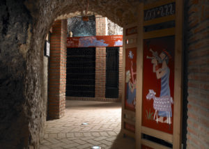 hilo de ariadna entrance to the unique antique styled wine cellar